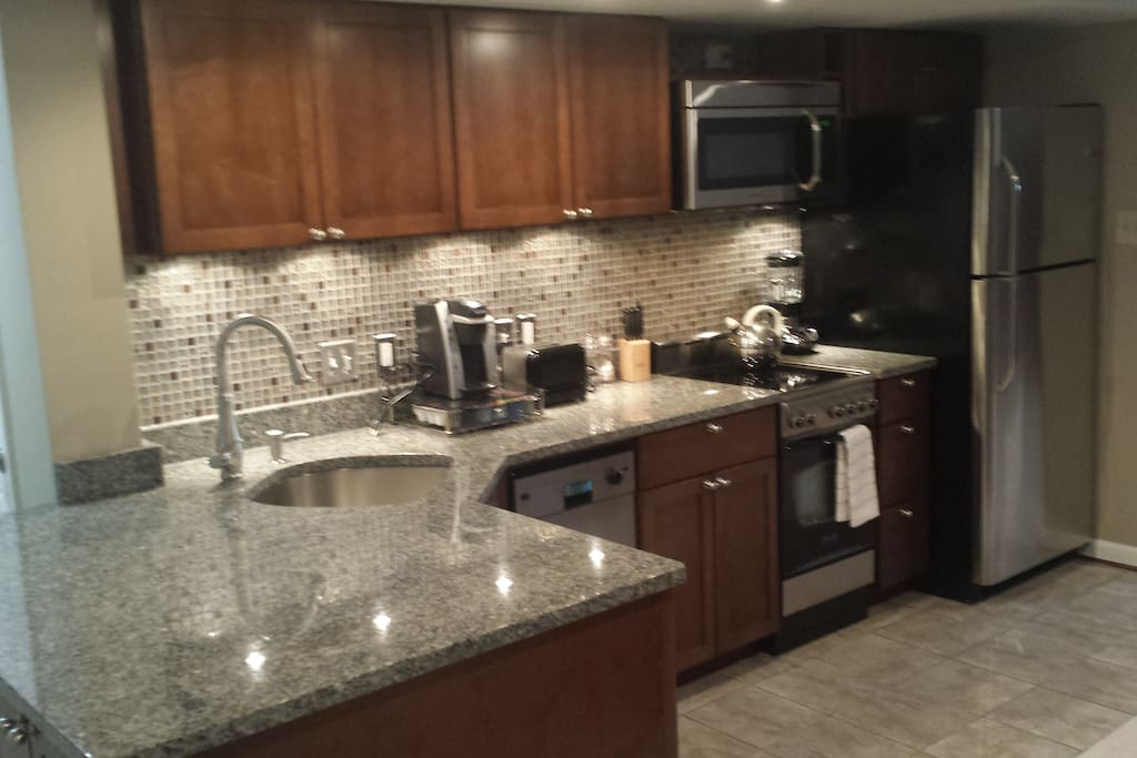 Newly renovated full kitchen with all pots, pans, coffee maker, toaster, tea pot, etc.