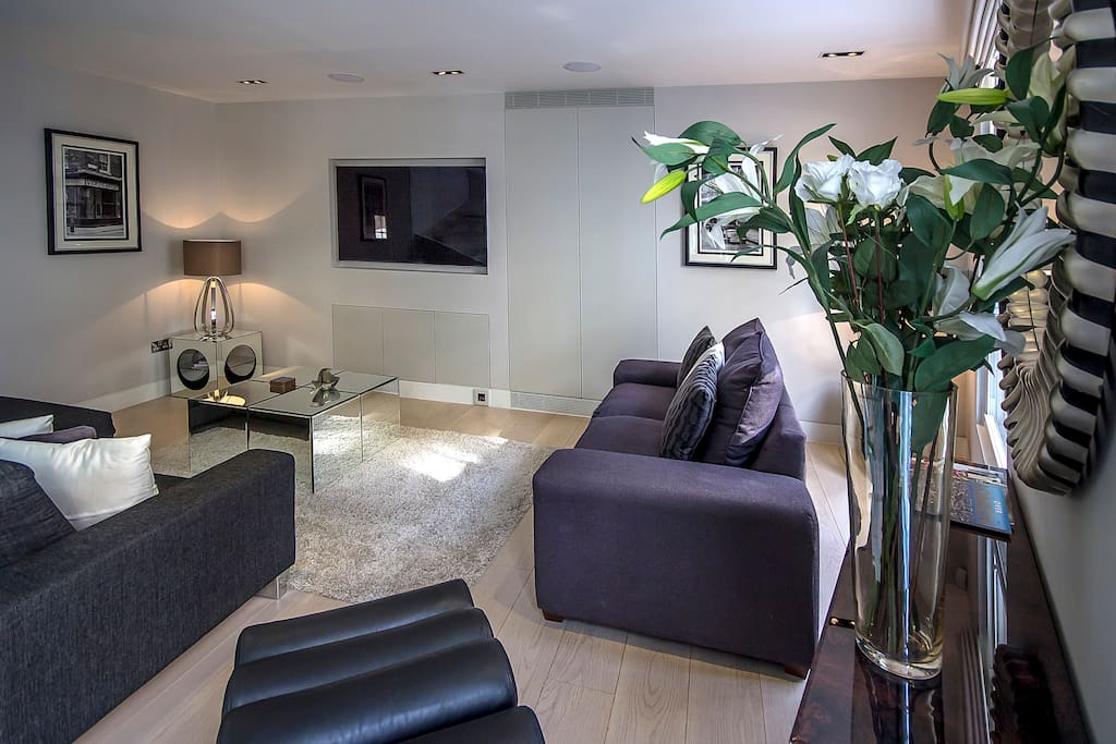 The light and spacious living room. Perfect for enjoying the big screen TV.