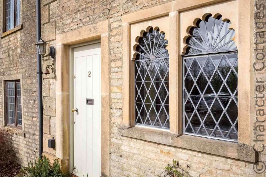The stunning Spa Changing Rooms, a historic cottage in the heart of the CotswoldsCosy and stylish living roomWith a roaring log burner for those colder nights in the countrysideHistoric feature windowsThe smart, well equipped kitchenLooking down to the h