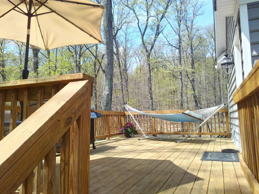 Private deck with gas grill and hammock.