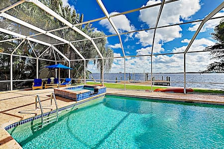 Riverfront Paradise w/ Caged Pool, Hot Tub & Dock