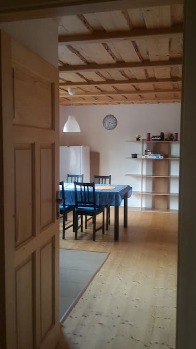 Ground floor from the main entrance. Fridge and dining table