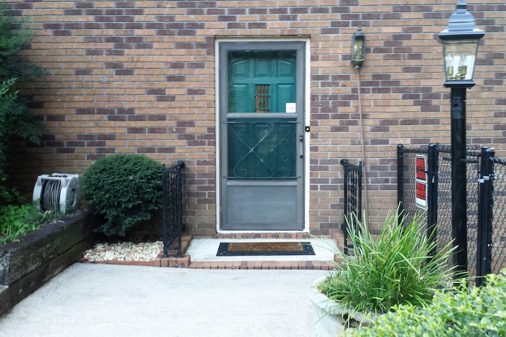 Private entrance with touch panel locking deadbolt