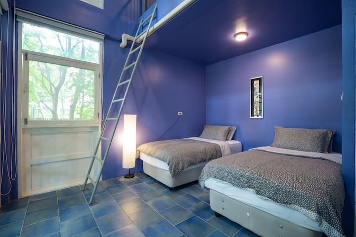 Bedroom 2 (ground floor) with access to mezzanine levels. (air conditioned in all rooms.)