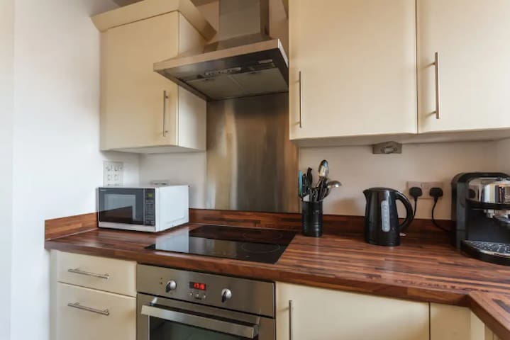 Kitchen includes electric hob and oven, built in grill and microwave