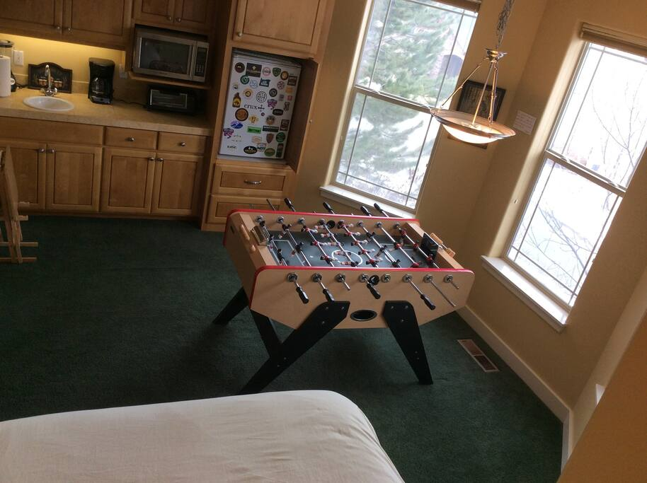 View from the bed.  Your own private kitchen with all the basic amenities and a fusball table.