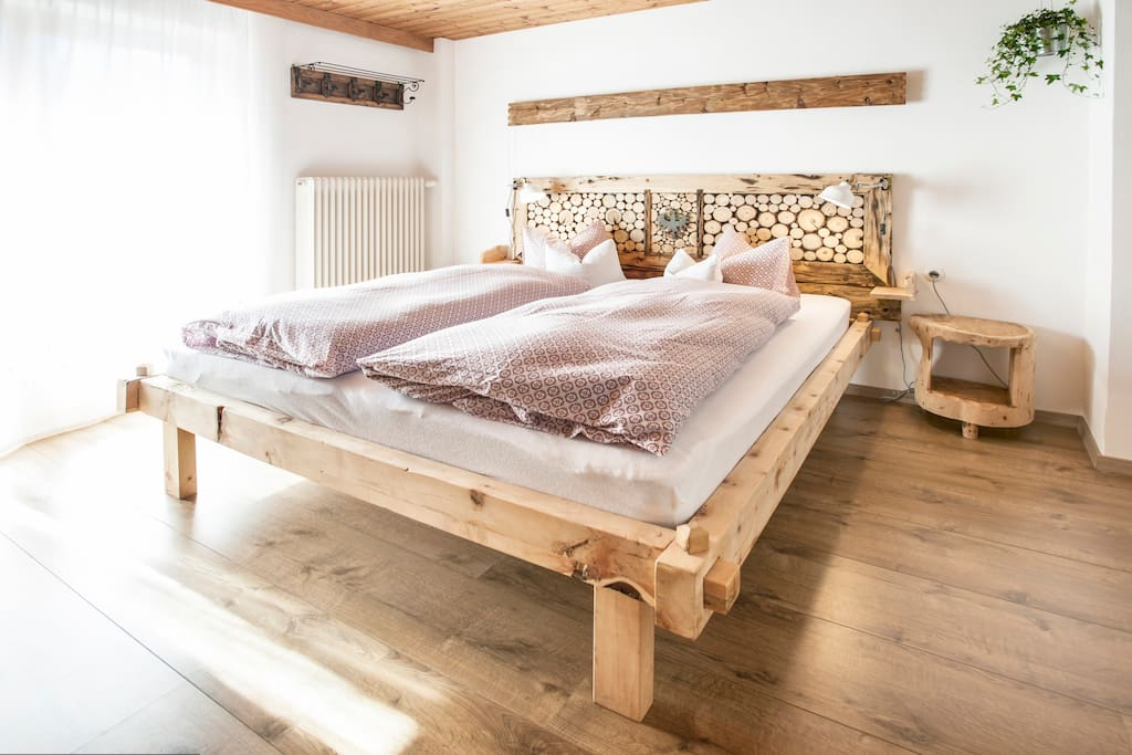 Handmade bed from pine wood