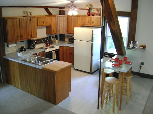 Never alone in the kitchen, open to dining and living area