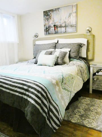 Comfy Queen bed with extra pillows and blankets in closet.