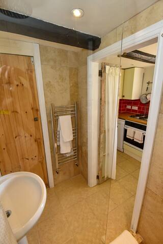 Shower room accessed through the kitchen