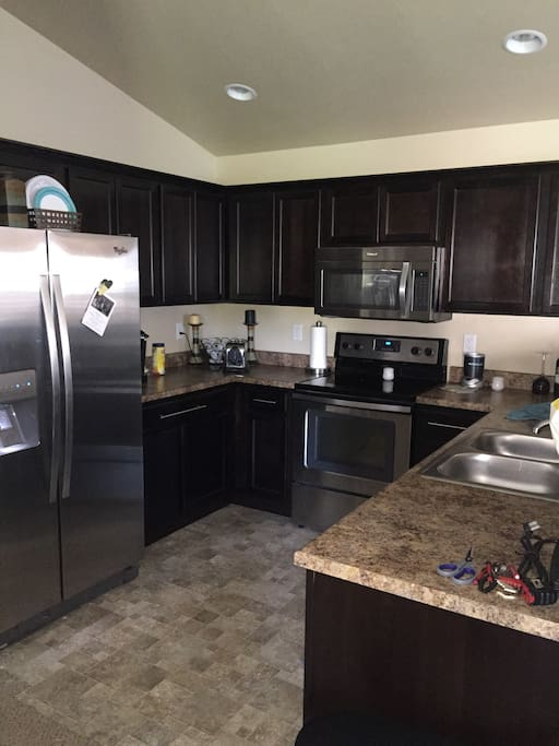 Clean, spacious open kitchen. Fully equipped with dishes, utensils and pots and pans for cooking. All appliances clean and modern.