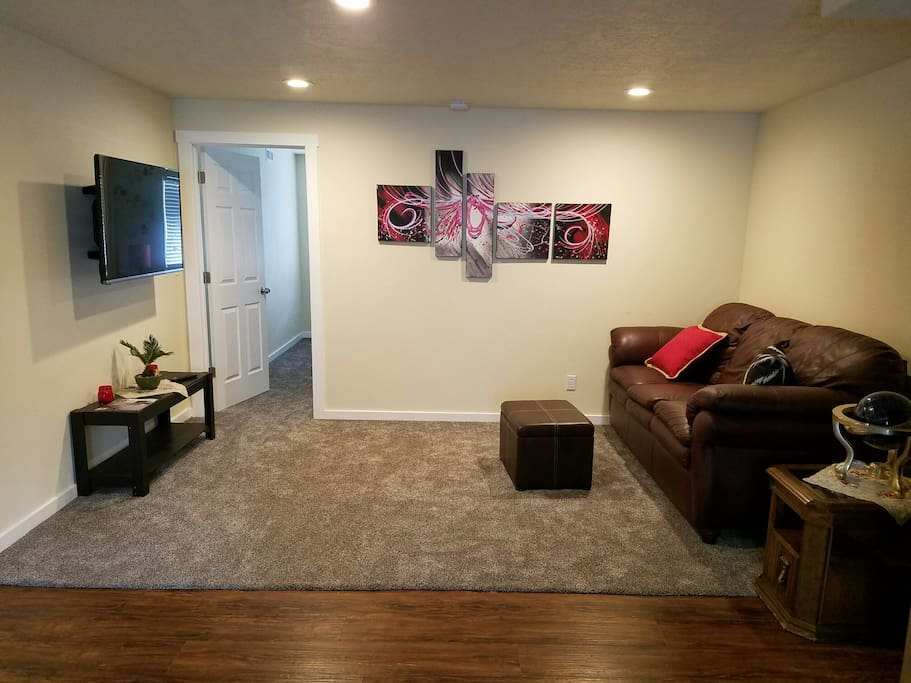 Comfortable Living area with canned lighting and a smart TV with a great picture