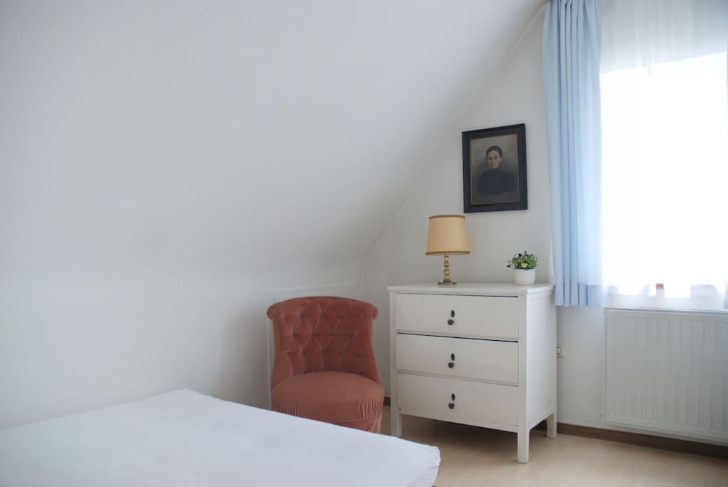 The bedroom with a comfortable double-futon and a chest of drawers