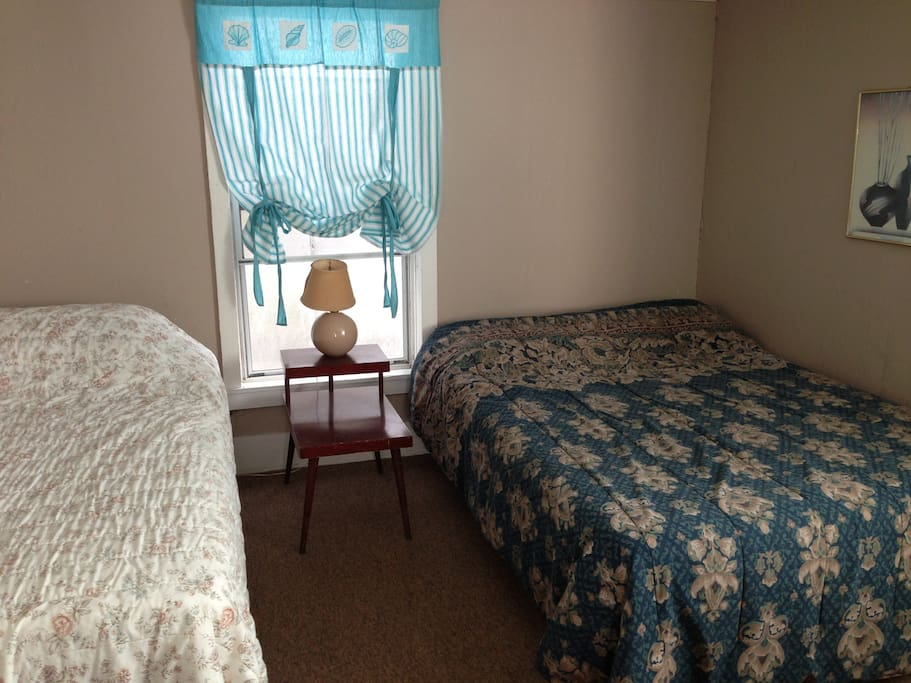Bedroom with one twin and one double bed