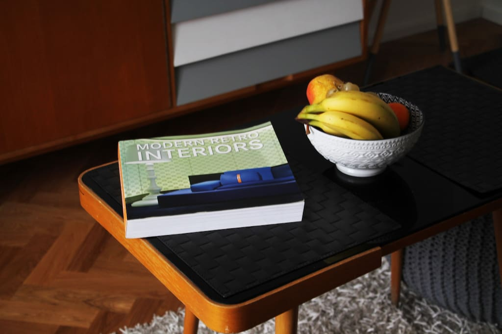 Coffee table with design book that inspired the interior of the apartment