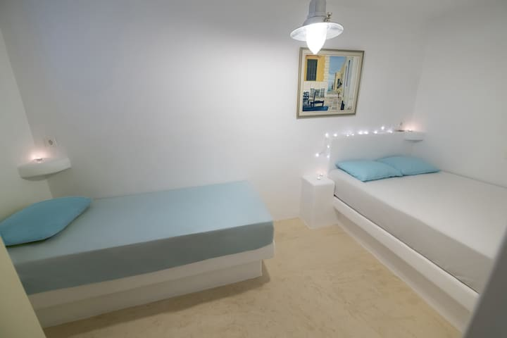 The bedroom with a built double bed and a built single bed.