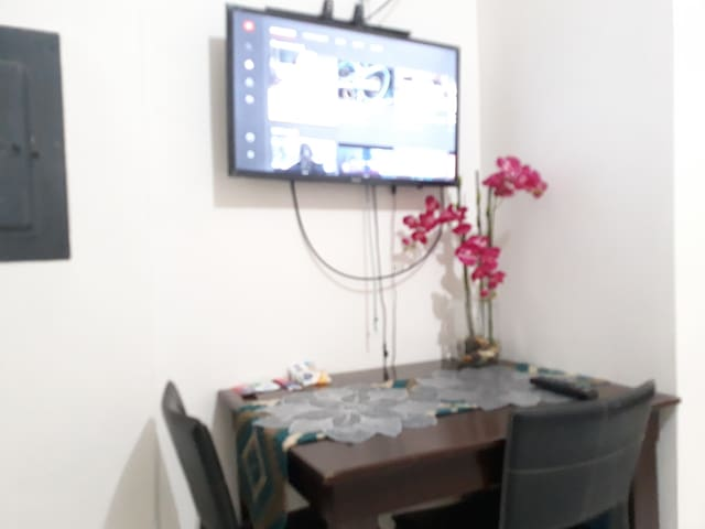The dining table and the smart TV connected to free wifi
