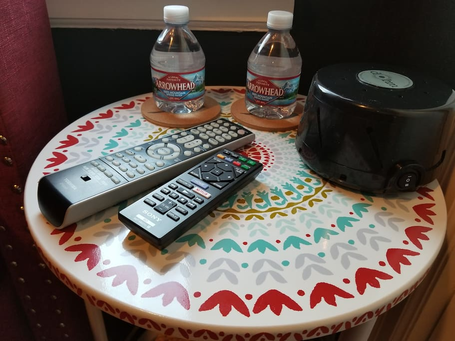 Complimentary water and the room's own white noise machine for comfort