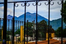 You can see a part of Antigua Guatemala at sunset. and you will see the volcanoes of fire and acatenango