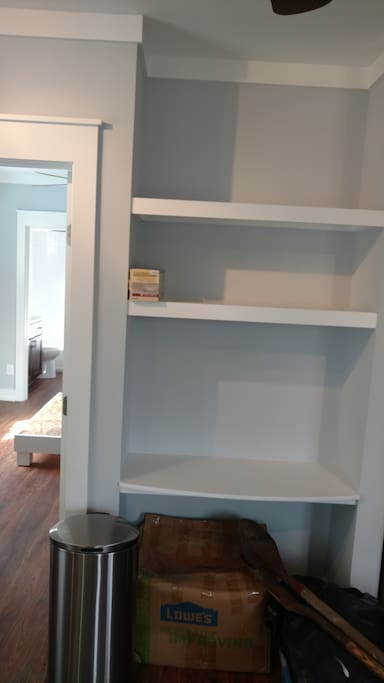 shelves for storage and working desk surface
