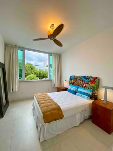 Private bedroom with a queen bed and air conditioning