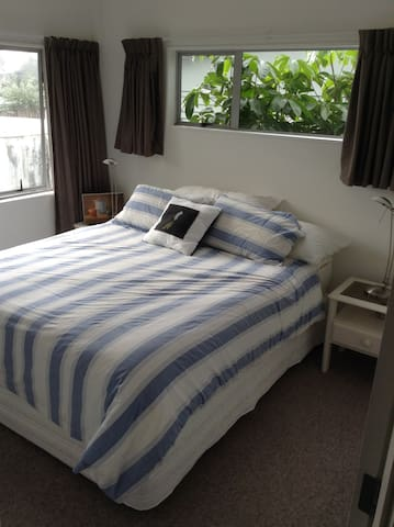 Light airy room with large comfy bed