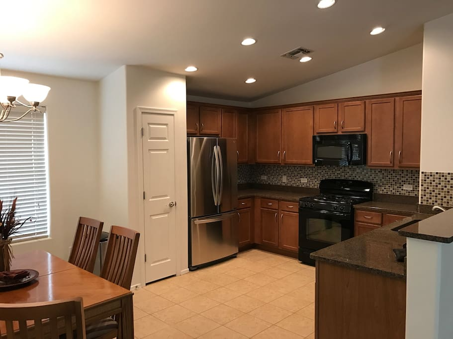The kitchen features granite, gas range, and brand new LG refrigerator.