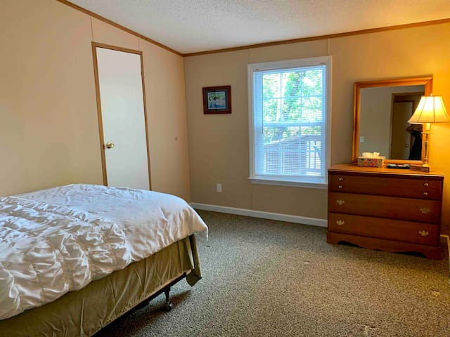 Guest bedroom with a full size bed