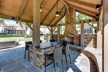 Outdoor pavilion with fireplace and TV