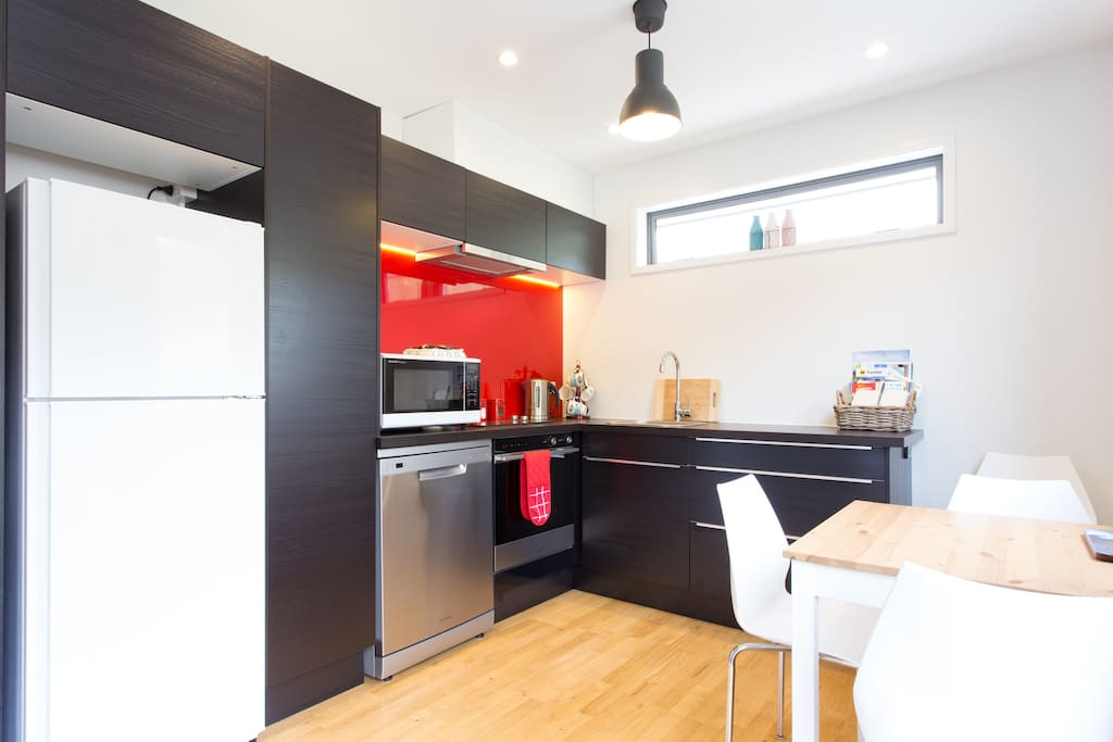 Kitchen with full fridge/freezer, dishwasher, ceramic cooktop, oven and microwave