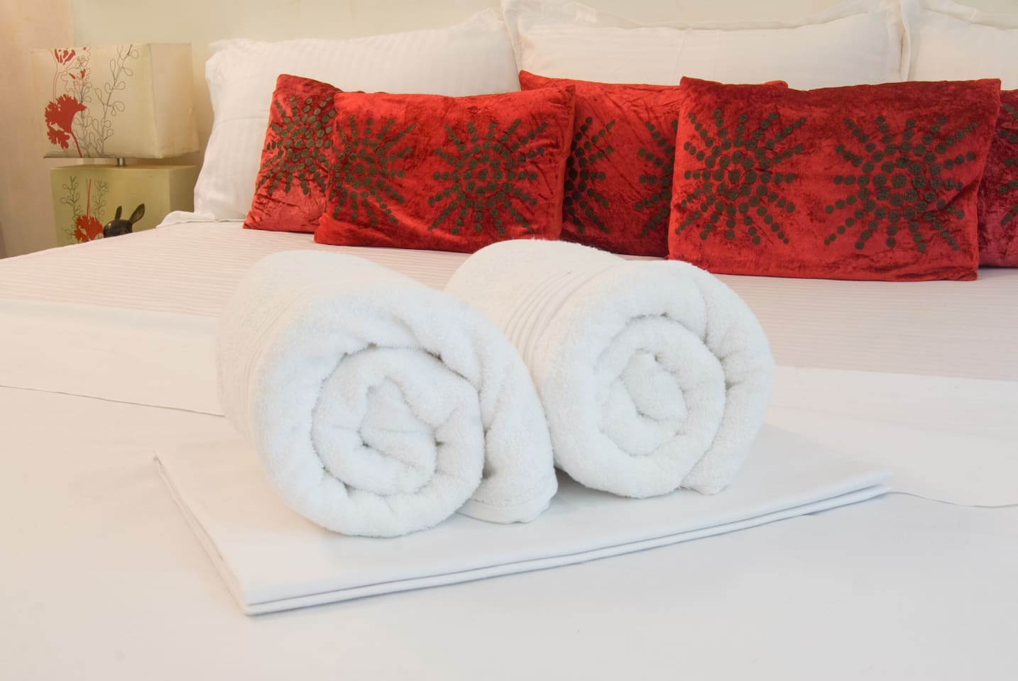Fresh bedsheets & towels,red cushions-color of Love & passion spread cheer.7ft x6ft kingsize bed