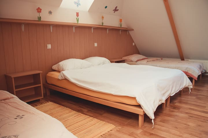 Bright bedroom upstairs with plenty of space for kids to play.