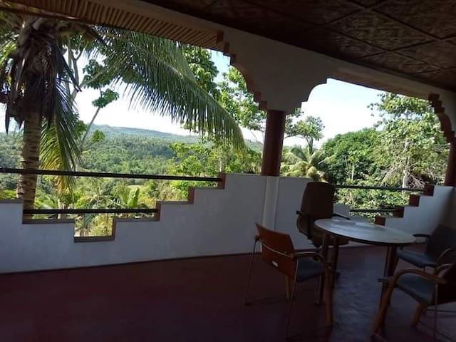 Manigos House