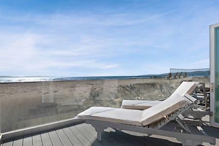 Gorgeous waterfront home w/ a private hot tub, gas fireplace, & beach access