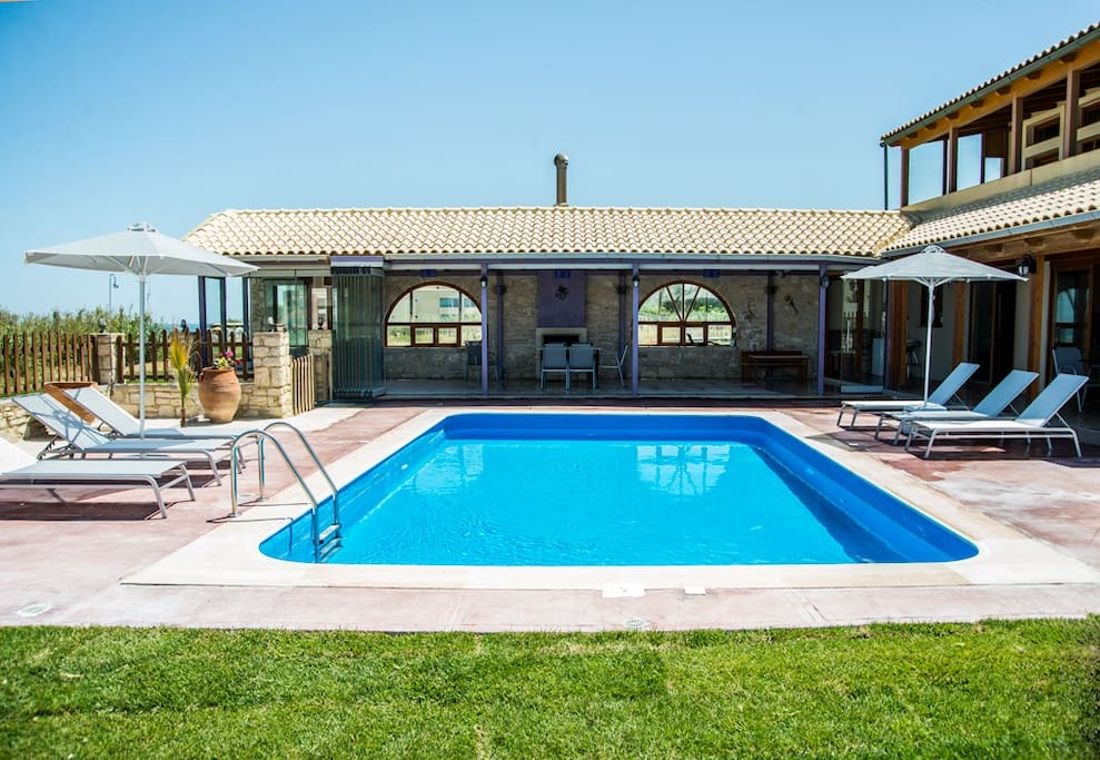 Exteiror view of the villa with its resting areas by the pool