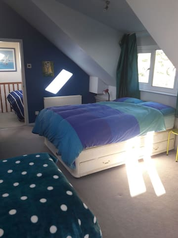 Large upstairs bedroom -   Ideal family room/group Can sleep up to 4 in a double and single bed, space for an additional single mattress on the floor, sink unit and storage.