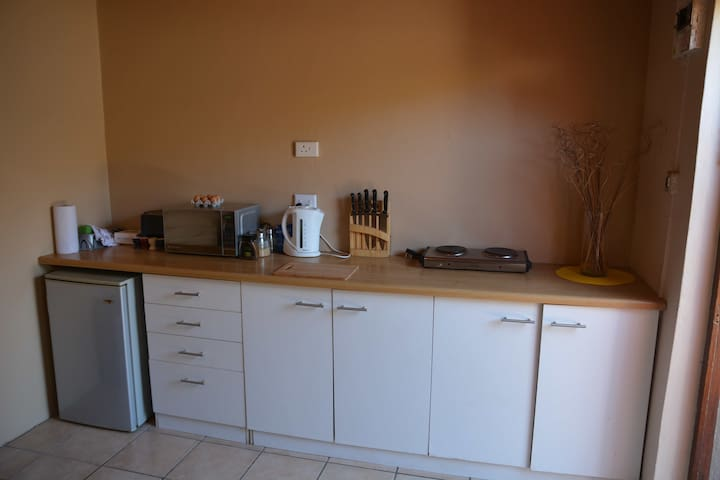 Kitchenette with fridge, microwave and hotplate. Complimentary tea and coffee included.