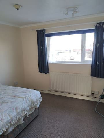 One room with double bed with mcColls near by