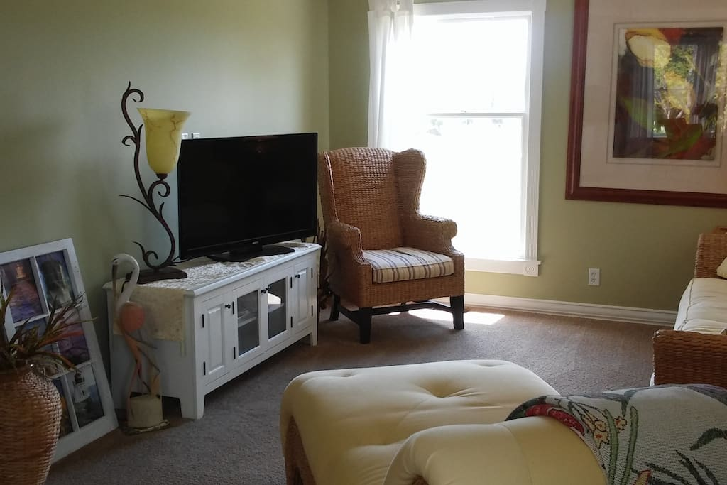 Flat screen across from sofas in Living area