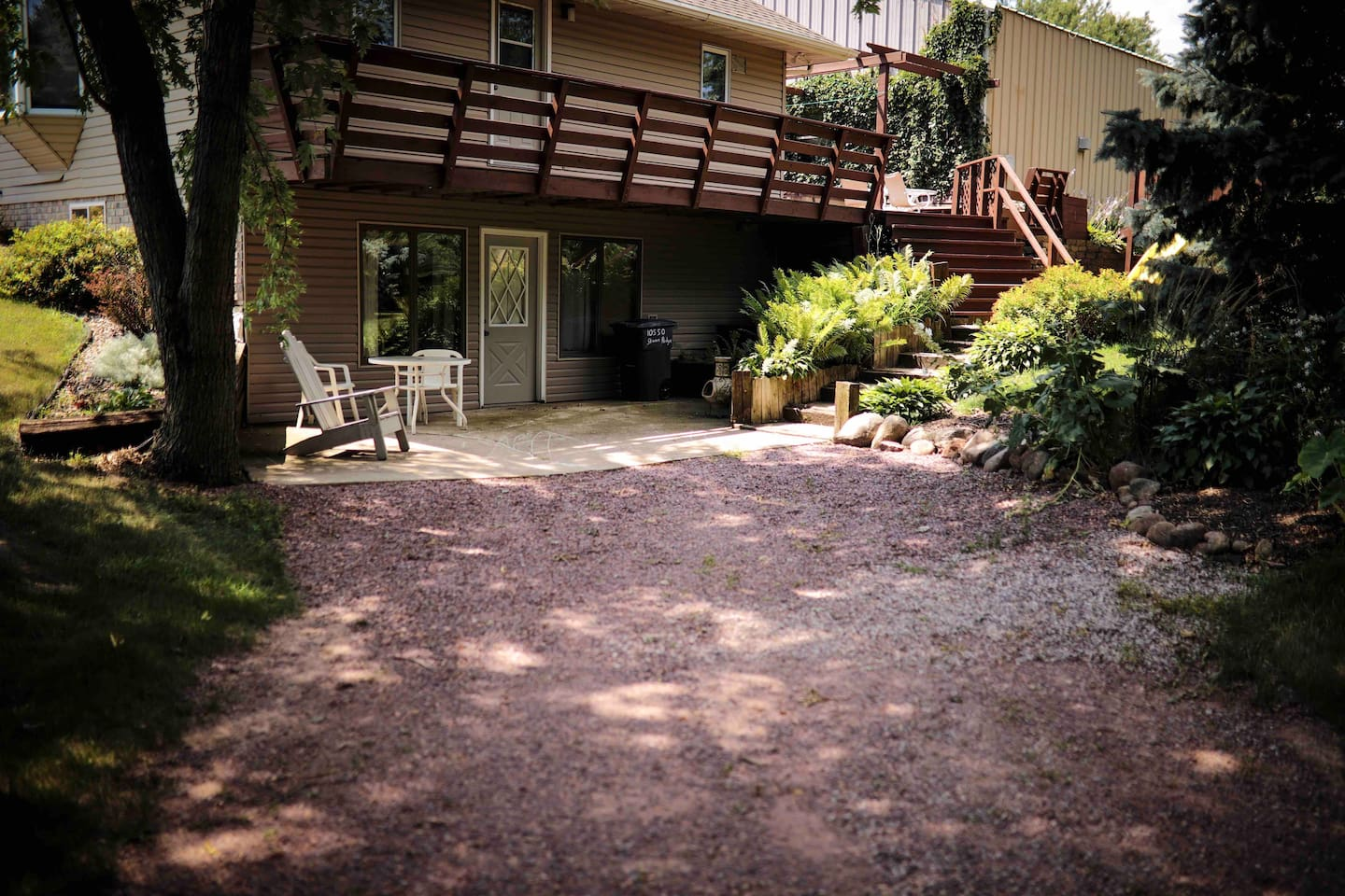 Private, drive up to patio entry to your lower level space.