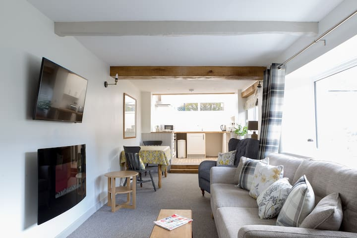 The open plan downstairs is light bright and airy and newly furnished and decorated to enhance the character of the cottage.