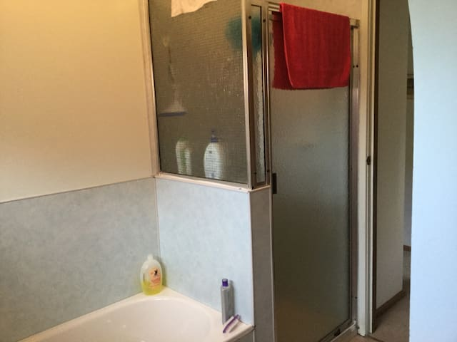 Shower & bath in shared bathroom.