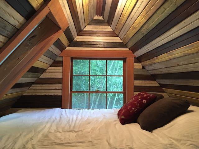 Our beautiful sleeping loft features an aloe cool memory foam queen sized mattress (likened to a cloud), whisper soft high thread count sheets, down comforter, skylight and a large window with a private view of the bamboo forest.