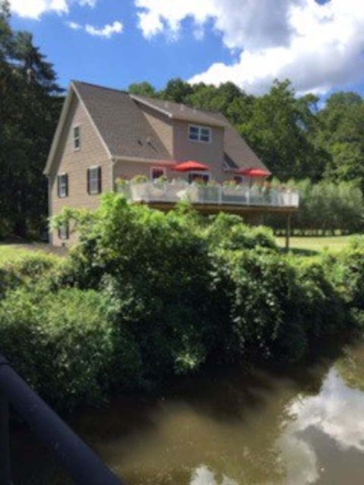 The lovely and spacious deck overlooks the old Delaware Canal and walking and biking paths.