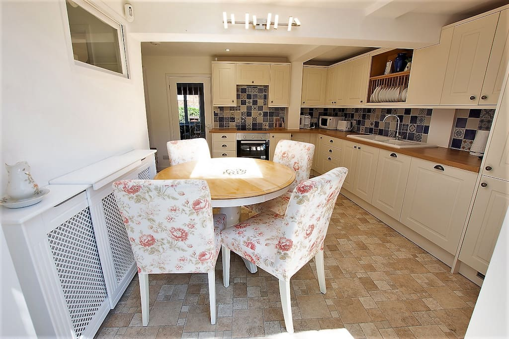 Kitchen and dining space, all modern white goods including dishwasher, washing machine and tumble dryer