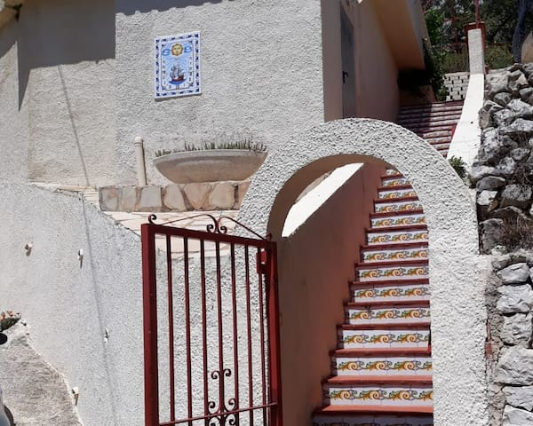 The stairs from the road up to the apartment are steep. If you expect to have any problems with them please let us know before you arrive and we can arrange it so you can drive up to the small space at the top.