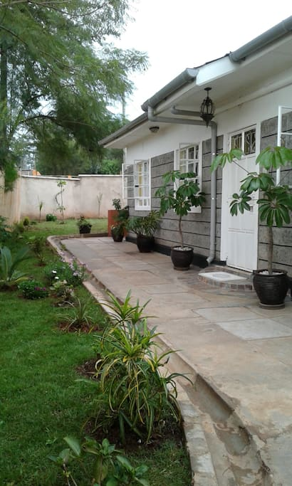 Our welcoming entrance with a variety of plants and flowers.