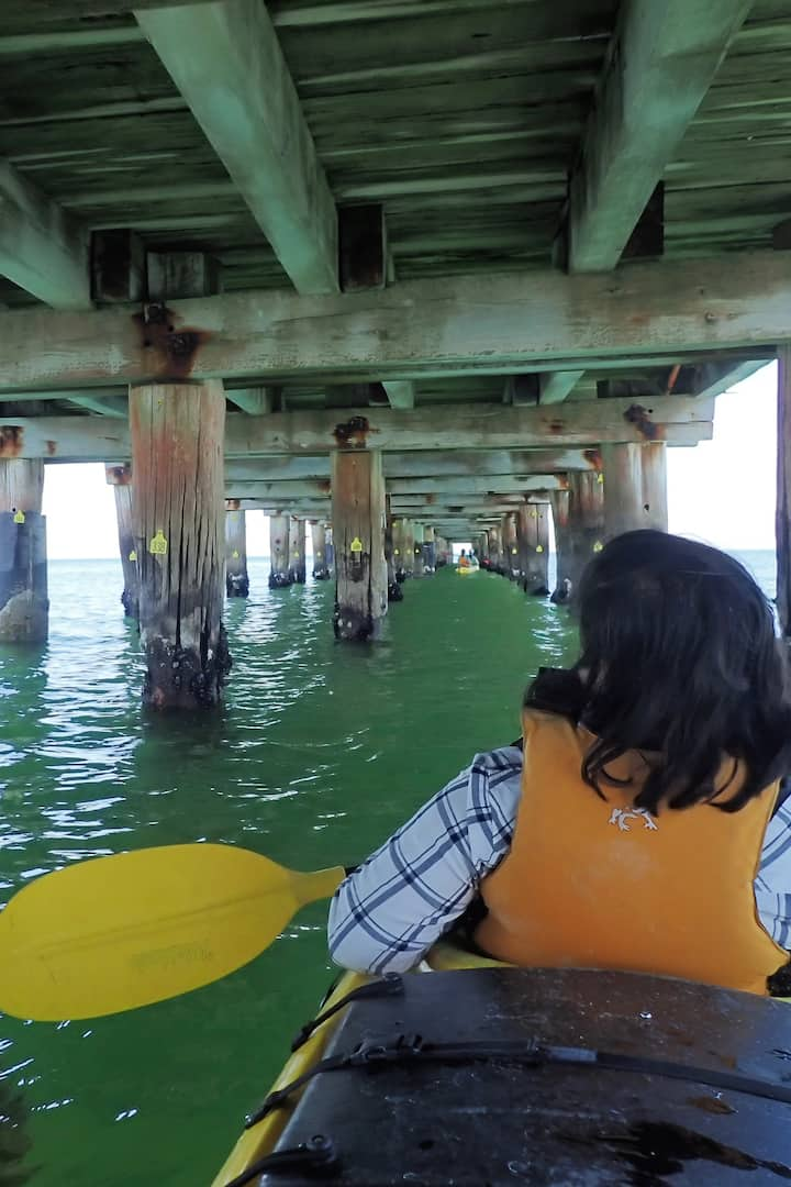 There are cool piers to paddle under