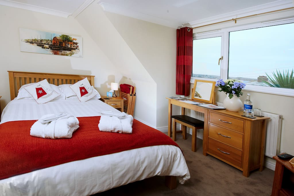 The Padstow room king size double bed with en suite shower room.