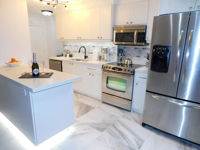 The fully equipped kitchen is open to the living room and dinning!